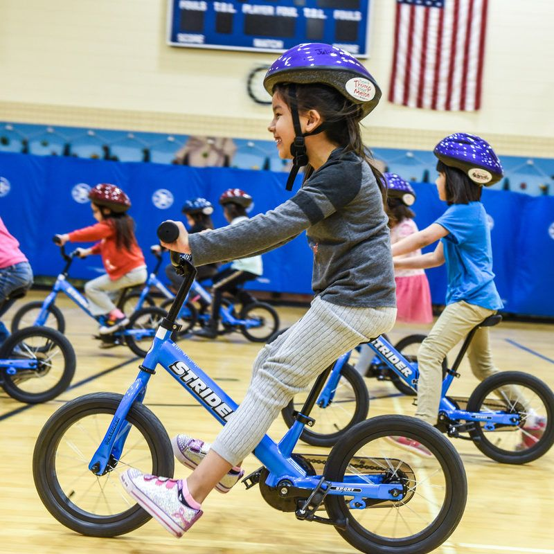 Students riding 14x Sport bikes in PE class